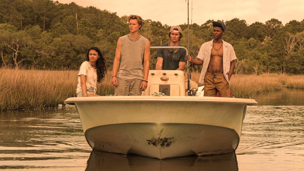 Outerbanks, les personnages principaux sur un bateau